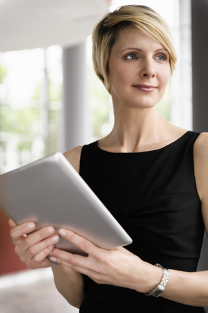 power operated: Businesswoman holding tablet computer LANG_EVOIMAGES