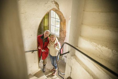 histories: Couple exploring medieval castle