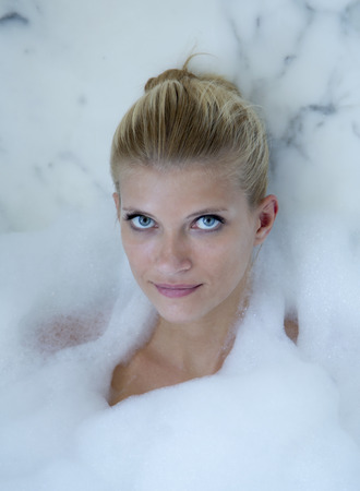 Woman relaxing in bubble bath LANG_EVOIMAGES