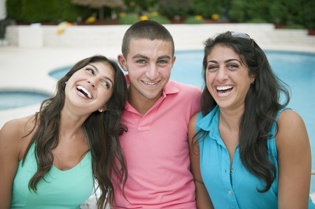 spirited: Brother and sisters smiling together