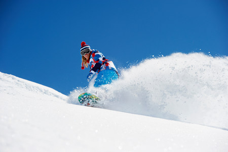 Female snowboarder in action