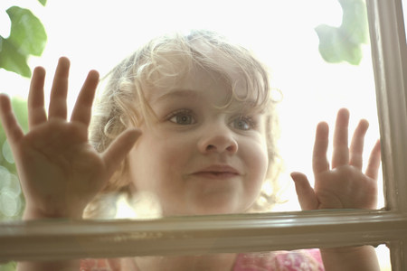 quizzical: Little girl looking in through window