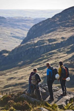 Hikers overlooking rural landscape