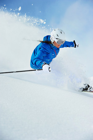winter blues: Young woman skiing