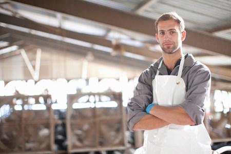 farmyards: Portrait of a dairy farm worker
