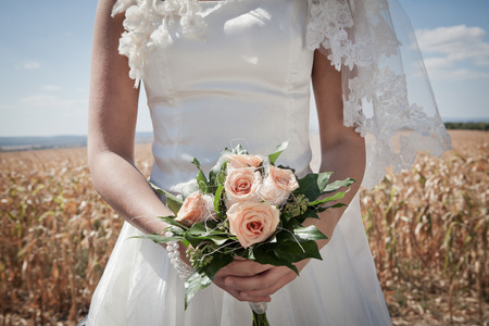 marrying: Newlywed bride holding bouquet