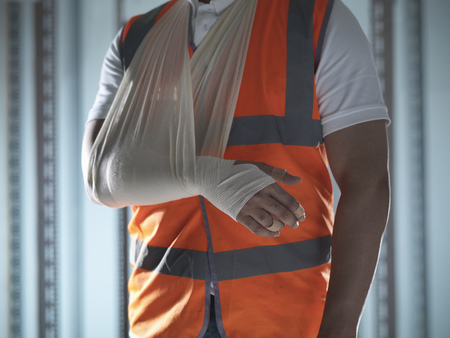 Close up of worker with arm in sling LANG_EVOIMAGES
