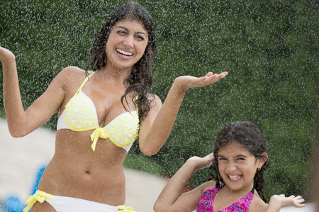 saturating: Sisters playing in water outdoors