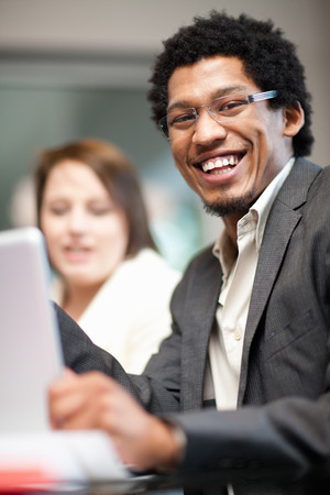 low spirited: Businessman smiling in meeting