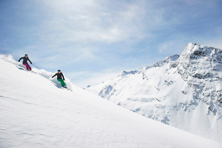 Two women skiing LANG_EVOIMAGES