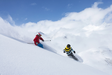 defended: Skier and snowboarder on snowy slope