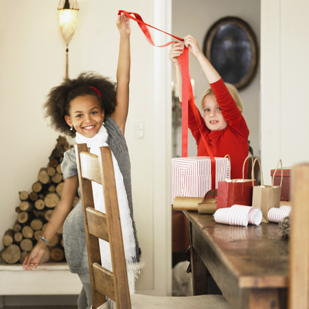 mischievious: Girls wrapping Christmas presents