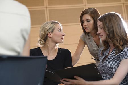 conferring: Businesswomen talking in office