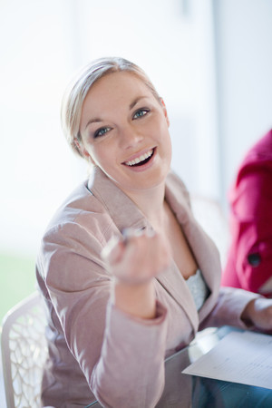 zeal: Businesswoman talking in meeting LANG_EVOIMAGES