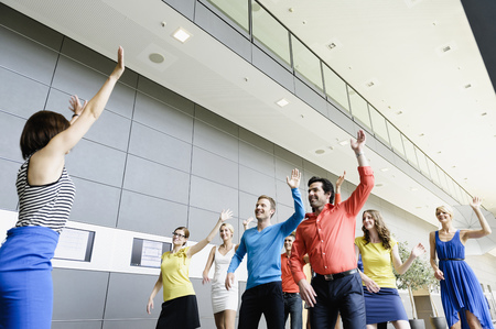 pursued: Business people dancing in office