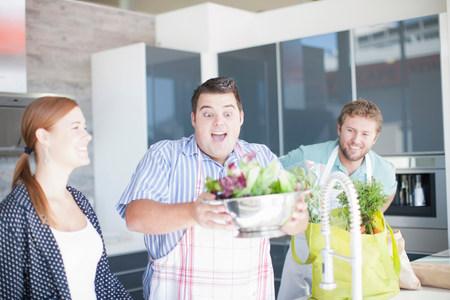 jesting: Friends preparing food together LANG_EVOIMAGES