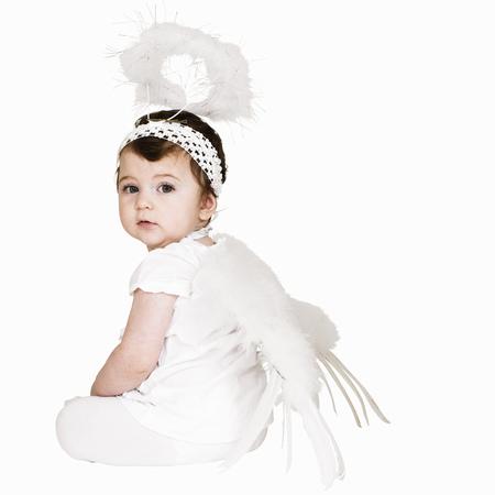Toddler girl wearing angel costume