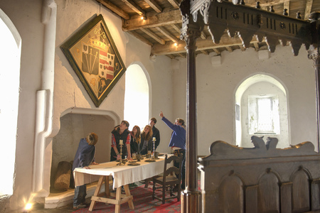 Students examining medieval tapestry LANG_EVOIMAGES