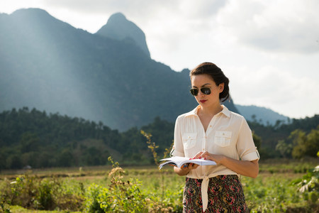 pastoral scenery: Woman reading book in rural scene,Vang Vieng,Laos