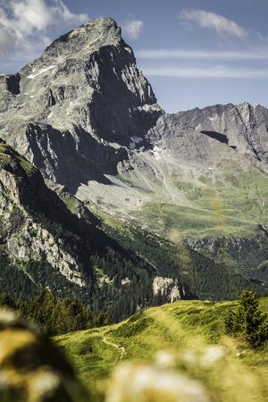 Rocky mountains over grassy landscape