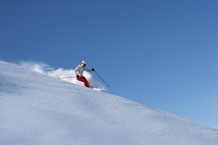 sprayed: Skier on snowy slope