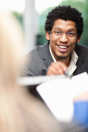 conferring: Businessman talking in meeting
