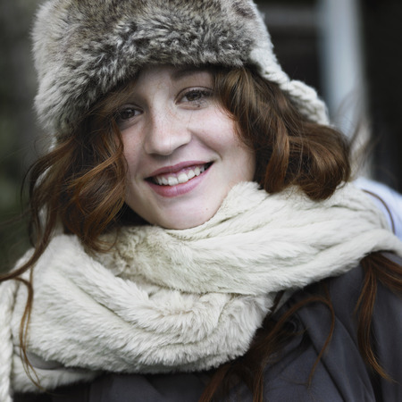 furs: Smiling woman wearing hat and scarf