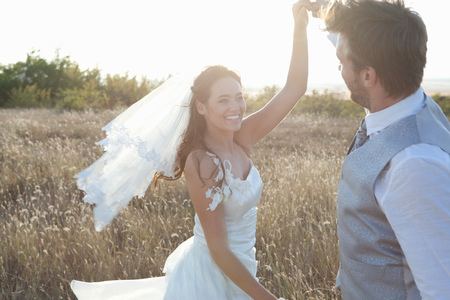 remoteness: Newlywed couple dancing outdoors