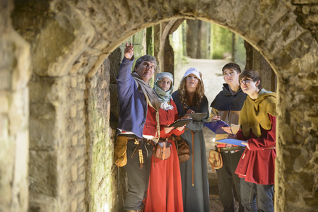 Students examining medieval castle LANG_EVOIMAGES