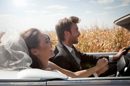 formals: Newlywed couple driving in convertible