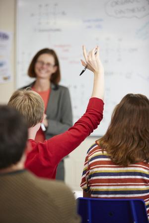 interrogations: Student raising hand in classroom