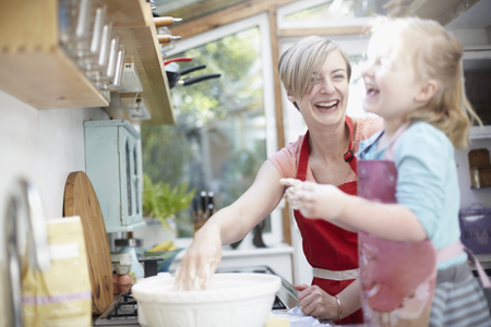 whimsy: Mother and daughter baking together