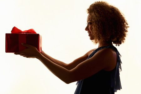 gratify: Woman holding wrapped gift