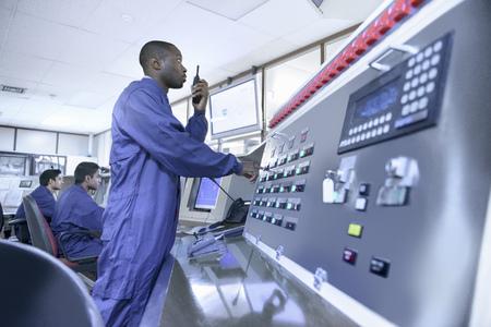 worked: Worker on walkie talkie in car factory