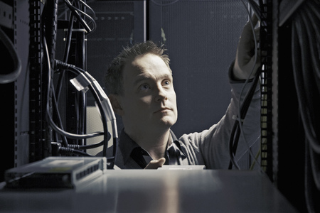 communicated: Man working in server room