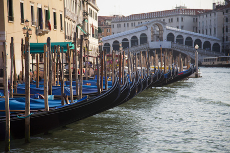Gondolas docked on Venice canal LANG_EVOIMAGES