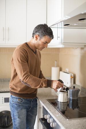 grays: Man making coffee in kitchen