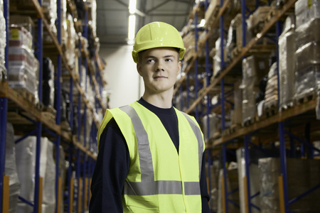 passageways: Smiling worker standing in warehouse LANG_EVOIMAGES
