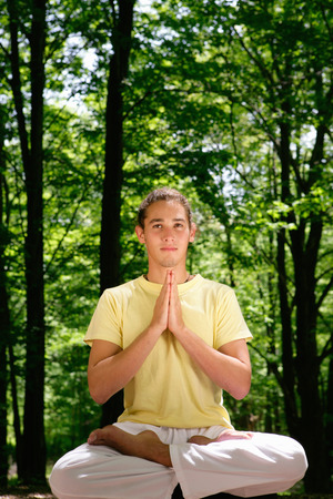 spiritual beings: Man meditating in forest