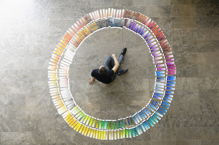 consulted: Businessman examining paint swatches