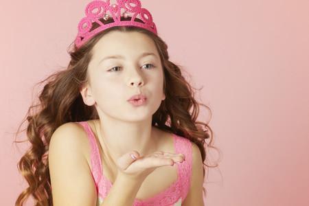 smooching: Girl in pink tiara blowing kisses