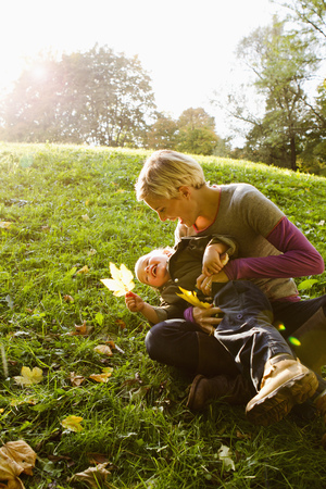 Mother and son playing in park LANG_EVOIMAGES