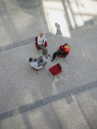 worked: Business people talking in office lobby