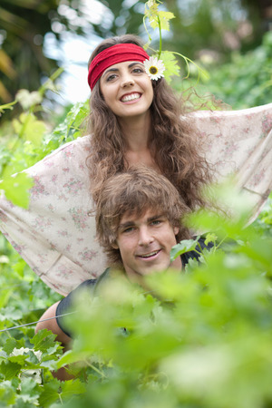 whimsy: Man carrying girlfriend in tall plants