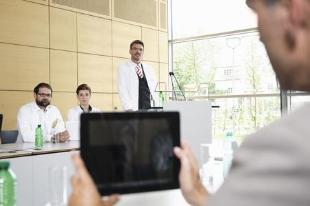 assemblage: Businessman using tablet computer