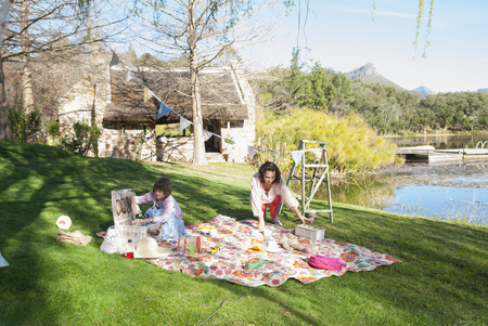 picnicking: Mother and daughter having picnic