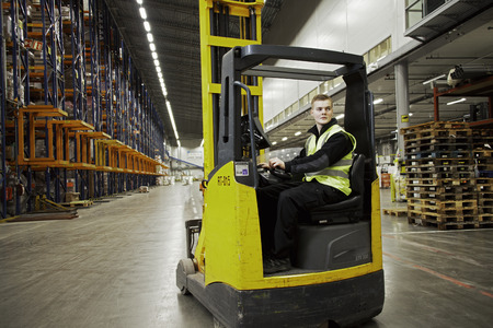 passageways: Worker operating forklift in warehouse LANG_EVOIMAGES