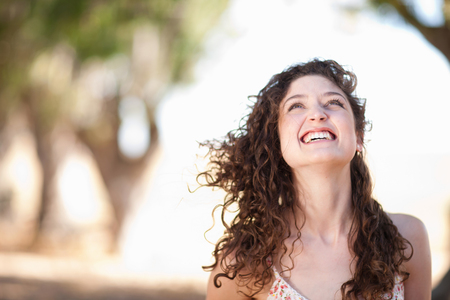 Smiling woman standing outdoors LANG_EVOIMAGES
