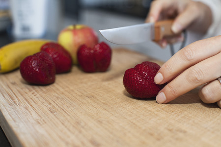 freshly prepared: Close up of woman cutting fruit LANG_EVOIMAGES