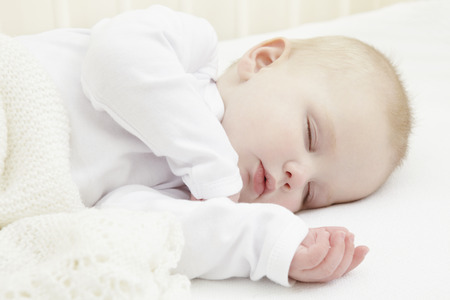 doze: Baby girl sleeping in crib